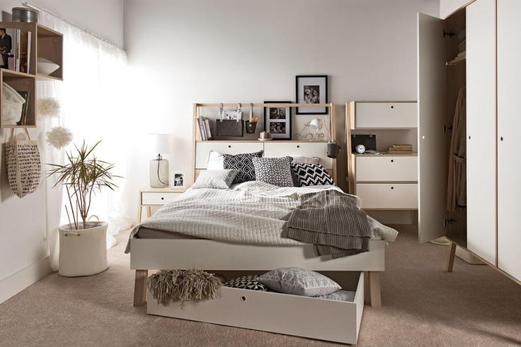 Voelkel Spot Collection, Queen Bed, Headboard with Storage, and Bed Slats on tape. The large headboard provides spacious storage, specially designed to be visually appealing. The railing can be used for hanging organizers, jewelry, lighting, and ornaments. The shelf can be used to hold books, a telephone, an alarm clock, or other items kept at hand. Fall front doors conceal a space large enough for extra bedding and pillows.