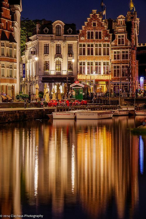 Since this is in Ghent, Belgium, I would most likely not travel here any time soon. However, I like how the reflection isn't a clear mirror image, but it is instead shown as lines of light.