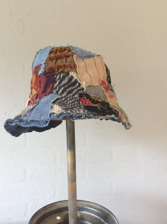 Handmade tattered patchwork boho bucket hat Upcycled textiles Inspired by Magnolia Pearl fashion Handstitched accents Slouchy shabby chic Bohemian gypsy look In black brown dark red blue and ivory Fits 22-1/2 - 23-1/2 head measurement One of a kind
