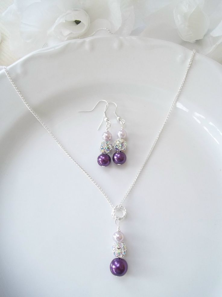Bridesmaid Wedding Jewelry Set, Purple Lavender Pearls, Rhinestones, Pendant, Wire Wrapped, Bridesmaid Earrings & Necklace Set. $18.99, via Etsy.
