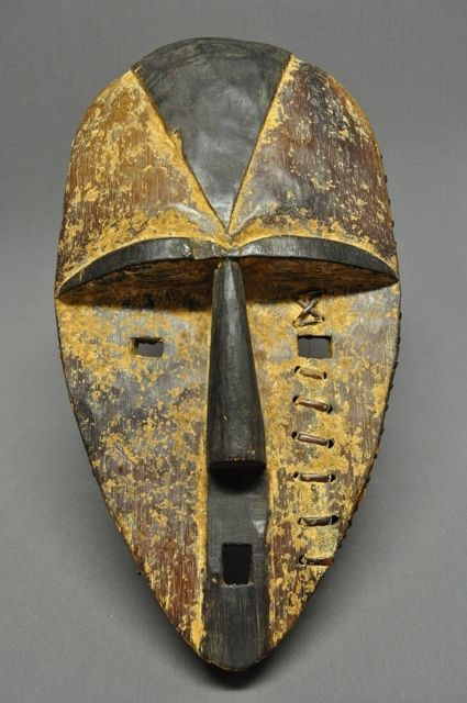 """Gabon Mask - Aduma   This Aduma mask is 17 1/2"""" long with traces of white pigment. There is also a native repair to the mask which has been stiched with a cane or fibrous material."""