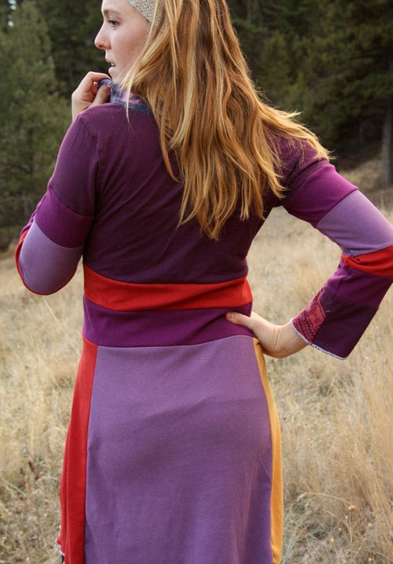 This vibrant dress is a colorful collection of upcycled cotton jersey knit materials. The focal point of the bodice is a beautiful graphically pleasing simplistic print in purple and pinky-orange . A soft lilac material with yellow and burnt orange side panels makes up the skirt. A cozy multi-colored cowl neck tops off this eye-catching number. As with all my designs, comfort is at the forefront of this garment. It moves with you to complement your life. SIze Small (4/6) (model pictured ...