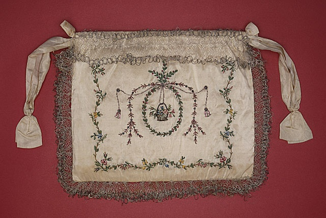 "Woman's ""indispensable"" (or pocket), English, circa 1799. Made of silk satin with silk thread embroidery, silk ribbon and foil bullion appliqué, sequins, and silk and metallic lace. Pockets were once separate from garments, like small purses that were worn under the clothing and attached to the body at the waist. A slit in the skirt would allow access to the pocket.: Metallic Lace, Silk Thread, Thread Embroidery, Pockets England, Woman Indispen, Silk Satin, Reticules Bags Pockets Wallets, Silk Ribbons, Metals Lace"