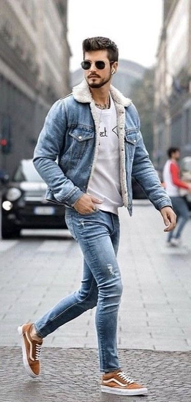 aaa24fc3cf3 Fall combo idea with a light blue shearling lined denim jacket white  printed t-shirt light blue skinny jeans brown vans old skool sneakers  sunglasses. model ...