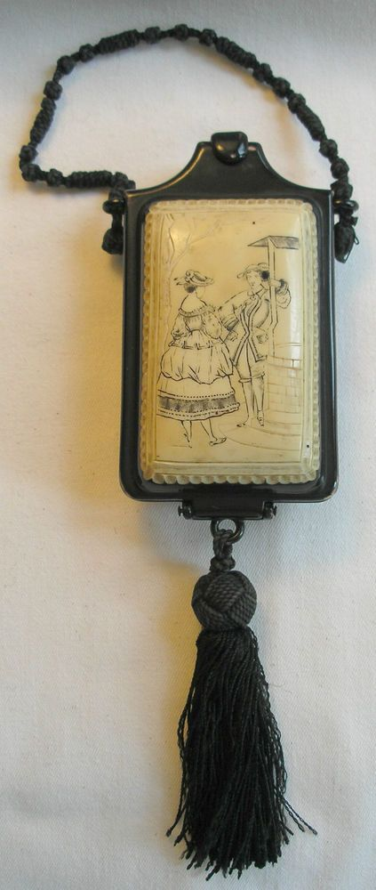Currency conversion chart in this unusual CELLULOID compact purse circa 1920s
