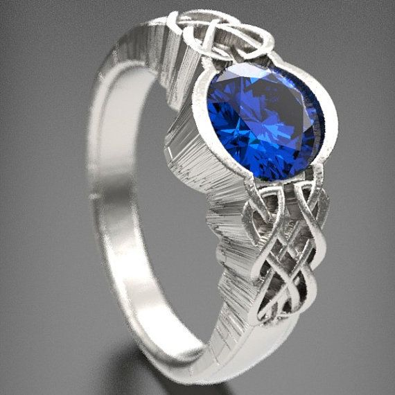 Unique Celtic Blue Sapphire Engagement Ring,Made in Your Size CR-1032-This design features a Celtic Dara Style design on each side of a center set blue sapphire stone. The Dara knot, as it is associated with the oak, reminds us that beneath our surface (beneath the soil) we have vastly divine inner resources (root system) that lend us wisdom and stability. What a great way to symbolize your love!  We offer different Finishing options. The finish u