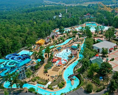 Magic Springs amusement and water park, Hot Springs, Arkansas. Notice that giant yellow roller coaster behind the water park!