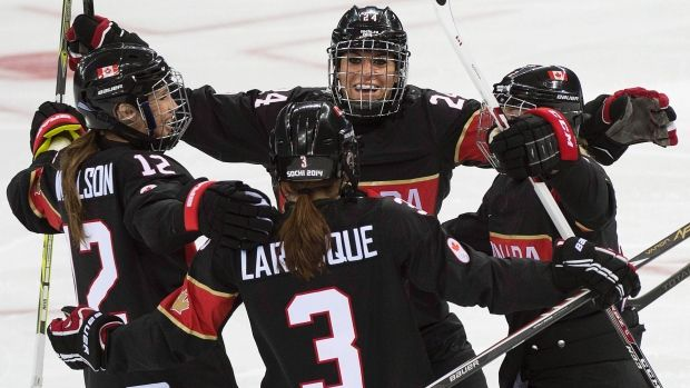Canada opens with 5-0 win over Switzerland in Olympic women's hockey.   SOCHI, Russia -- The Canadian women's hockey team found their legs quickly Saturday after a late night at the opening ceremonies of the 2014 Winter Olympics.  The Canadians pelted Switzerland's goaltender Florence Schelling with 69 shots and earned a 5-0 victory to open defence of their gold medal.