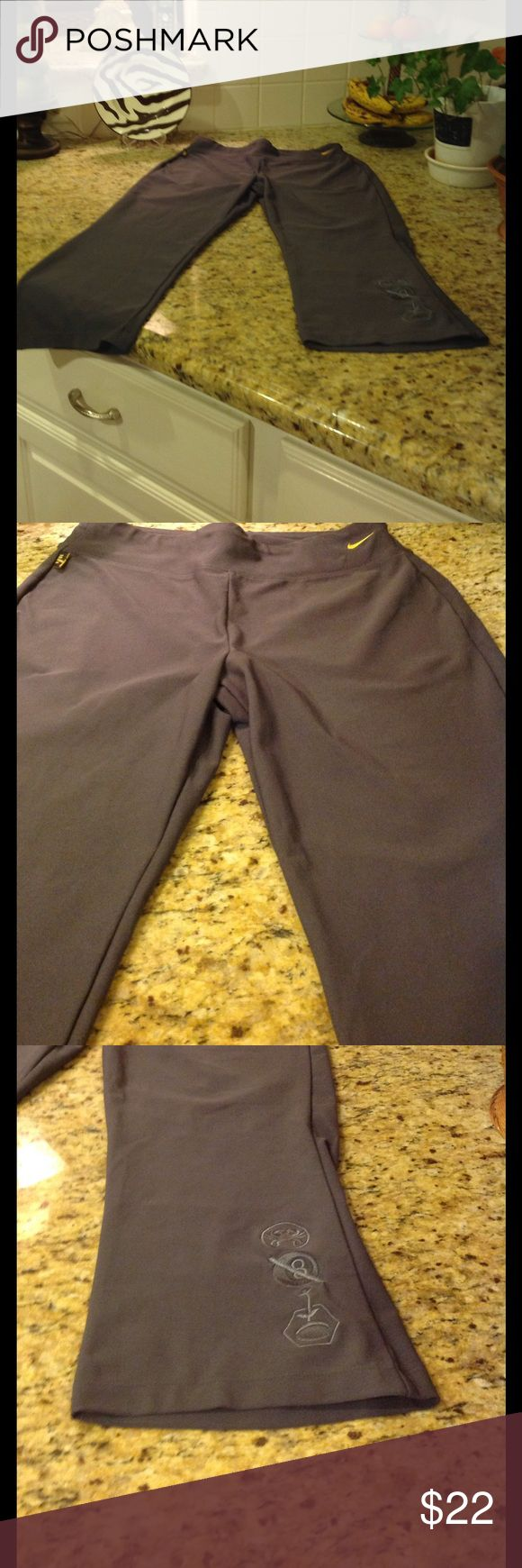 Like New! Nike Capris - Dri-Fit - color Gray Like New !  Only wore them a couple of times - Nike Dri-fit Capris - Gray color Nike Pants Capris