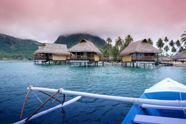 FP, Huahine, Hotel Sofitel Heiva, bungalows over water, vu fr outrigger canoe C1766 - Carini Joe/Getty Images