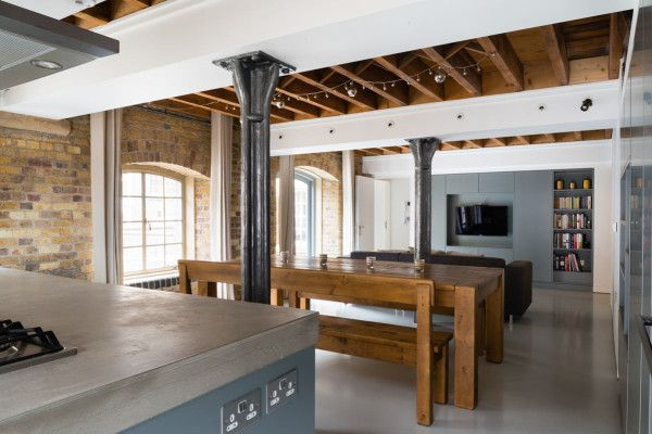A 19th century warehouse apartment is stripped to reveal its original, industrial charm.