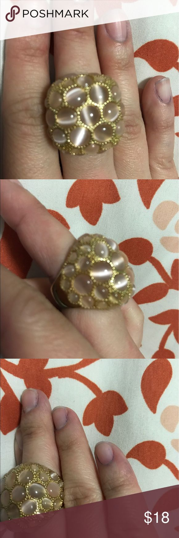 Tan cat eye ring with gold accents Love costume rings that grab attention?  This one is perfect!!!! Several tan cat eye stone surrounded by gold with gold band....EUC.....size 4-5 Jewelry Rings