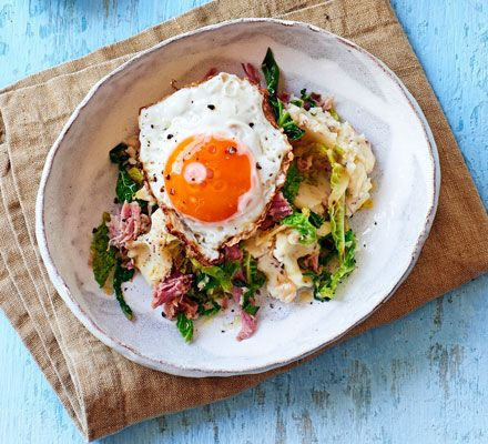 Creamy, comforting mash with garlic and double cream, chunks of ham hock and shreddedSavoy cabbage. Serve a bowlful topped with a runny fried egg