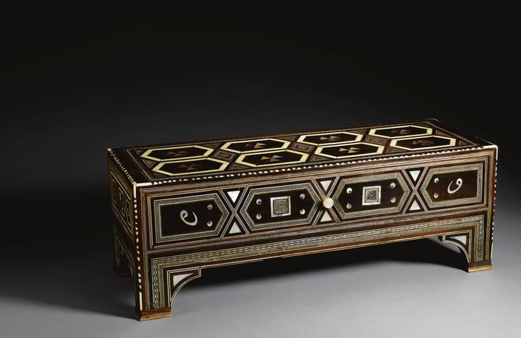 AN EXCEPTIONAL OTTOMAN CALLIGRAPHER'S TABLE, TURKEY, SECOND HALF OF 16TH CENTURY of rectangular form on four small arched feet with a drawer, composed of walnut, rosewood, ebony and inlaid with tortoiseshell, mother-of-pearl and ivory with an hexagonal pattern and alternating black and white geometric borders, some panels with a letter, with stylised cintamani motifs, or square kufic each with a shahada
