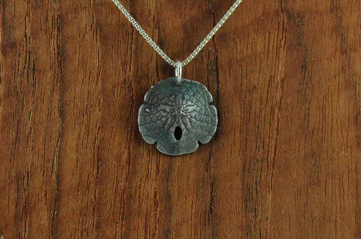 Small sterling silver Denman Island sand dollar pendant $135