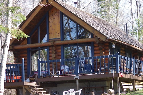 Log cabin with blue trim..