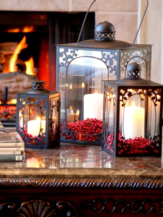 Gorgeous Lanterns...decorated with candles & berries for Christmas.