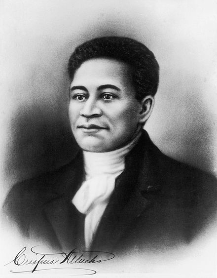 "Crispus Attucks (c.1723-1770) was a slave, merchant seaman, and dock worker of Wampanoag and African descent. Many people believe that he was the first person shot to death by British redcoats during the Boston massacre. He, along with Samuel Gray and James Caldwell died ""on the spot"" during the incident. Historians disagree on whether he was a free man or slave. Attucks, in the 19th century, became an icon of the anti-slavery movement. His grave is in the Granary Burying Ground, Boston."