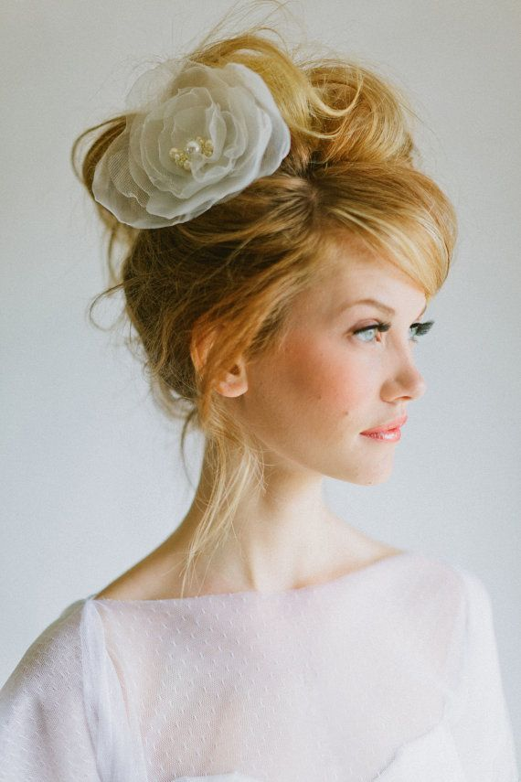 1960s inspired boufant updo with silk flower headpiece. Visit www.rosetintmywedding.co.uk for bespoke planning and design