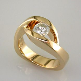 This Elegant Engagement Ring Has A Low Profile And Is Easy To Wear