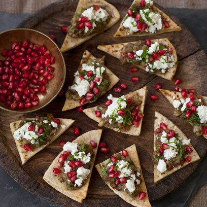 Crispy pitta chips topped with aubergine, pomegranate and mint. For the full recipe, click the picture or visit RedOnline.co.uk