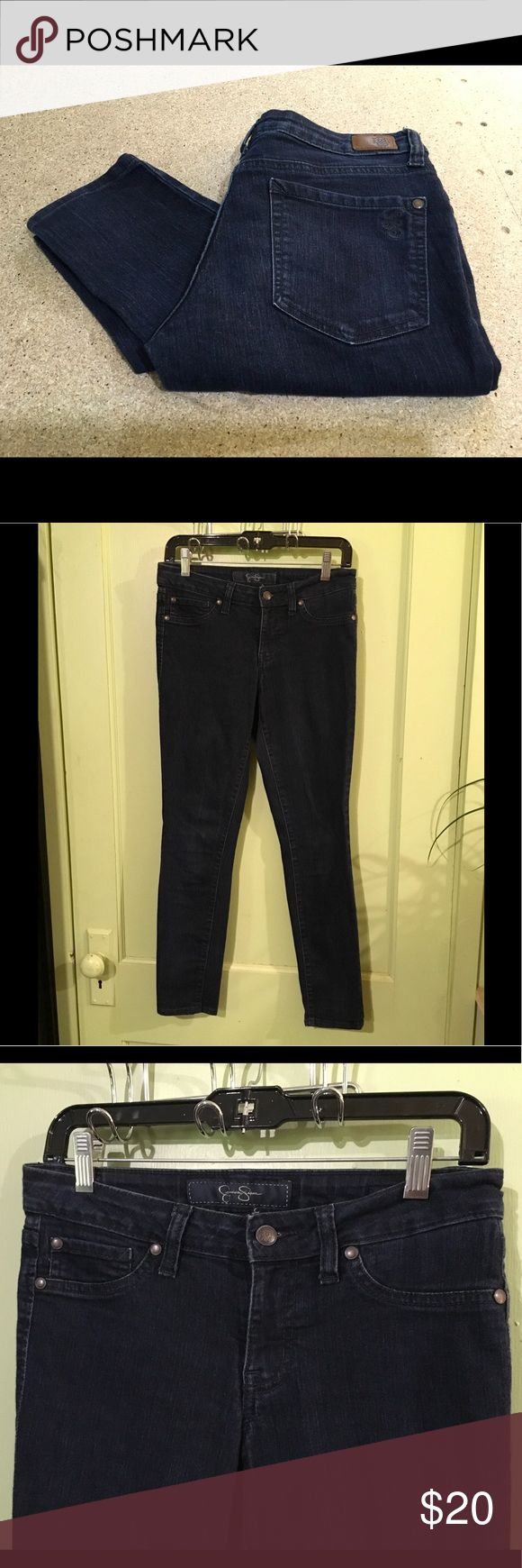 "JESSICA SIMPSON - Kiss Me Dark Wash Jeggings Jessica Simpson pants Size: 28 Descriptions: ""Kiss Me Jeggings."" Dark wash skinny crop jeans. Belt loops. Faux pockets in frontOpen pockets on front and back. Stretch. 82% cotton/17% polyester/1% spandex. Condition: Excellent used condition. Slightly wrinkled from storage. Dimensions: 28"" inseam. 28"" waist. 36"" from waistband to leg hem. 5.5"" opening at leg hem. 8"" rise. 33"" hips.  Inventory Reference: #P336 Jessica Simpson Jeans Skinny"