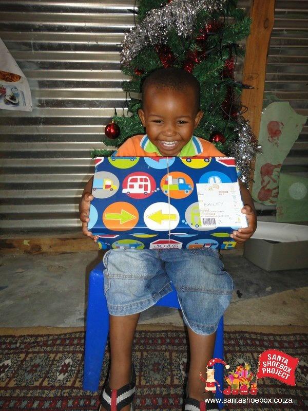 Santa Shoebox Celebration Parties! - I hope our boxes create smiles like this one.  :-)
