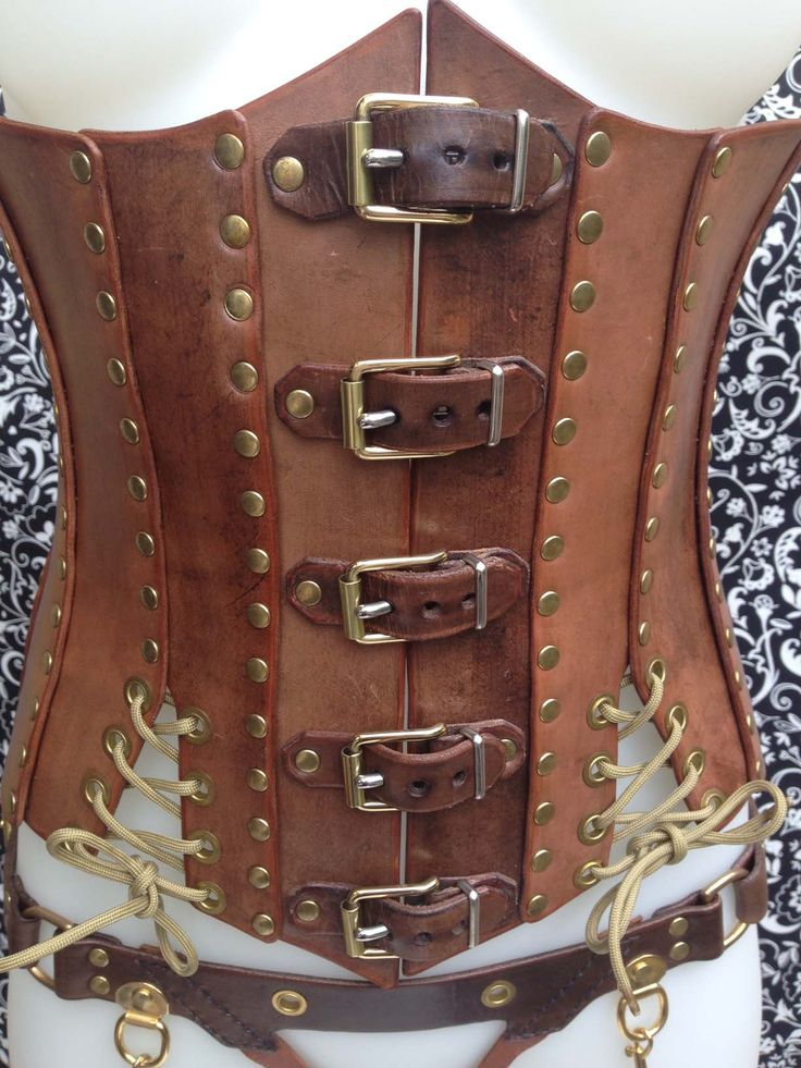 Leather Corset - Steam Punk - Brown, Tan & Gold. Dual thickened leather panels with rivet features. Buckled front to make it easy to put on by yourself. Gold Paracord lace over hips to allow for adjustment of hip size.