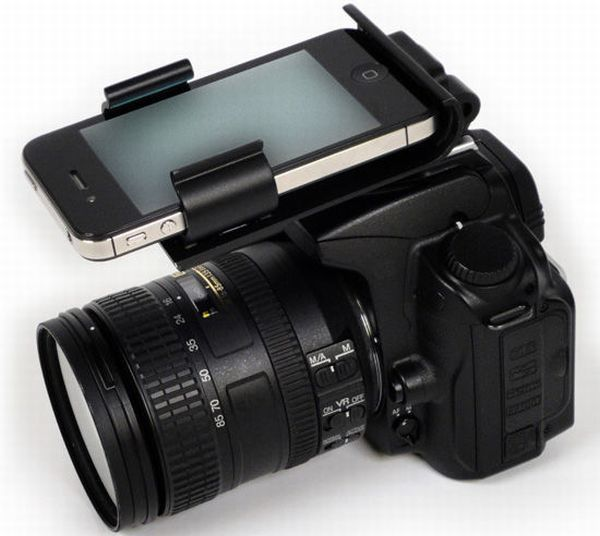 Flash-Dock merges a smartphone with a DSLR via the Cobra flash socket. Gives you a feee hand when used with an Eye-Fi SD card and a Wi-Fi connection.