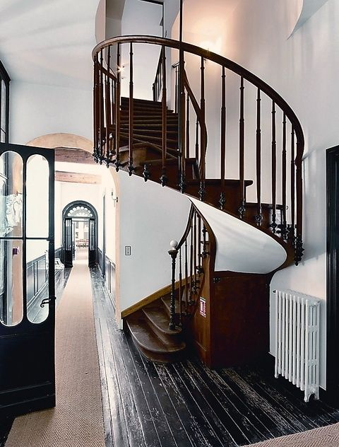 Spiral Staircase // Dark floors + White Walls