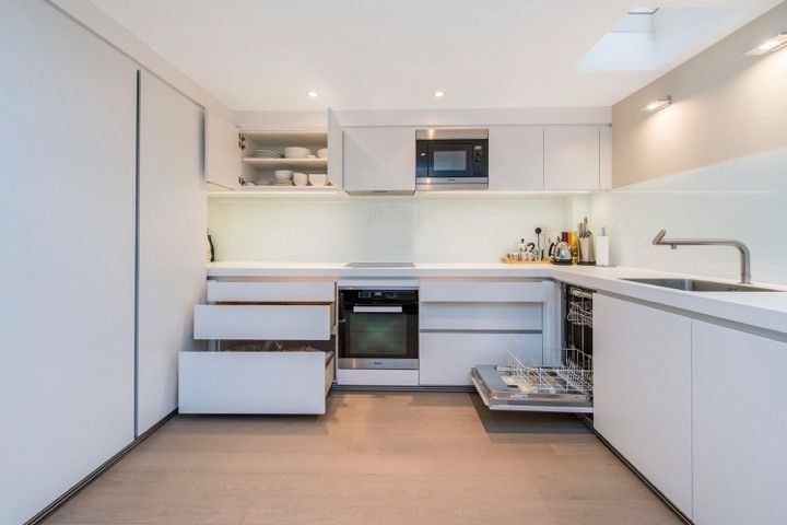 bulthaup b1 kitchen in Alpine White matt lacquer. Miele appliances.