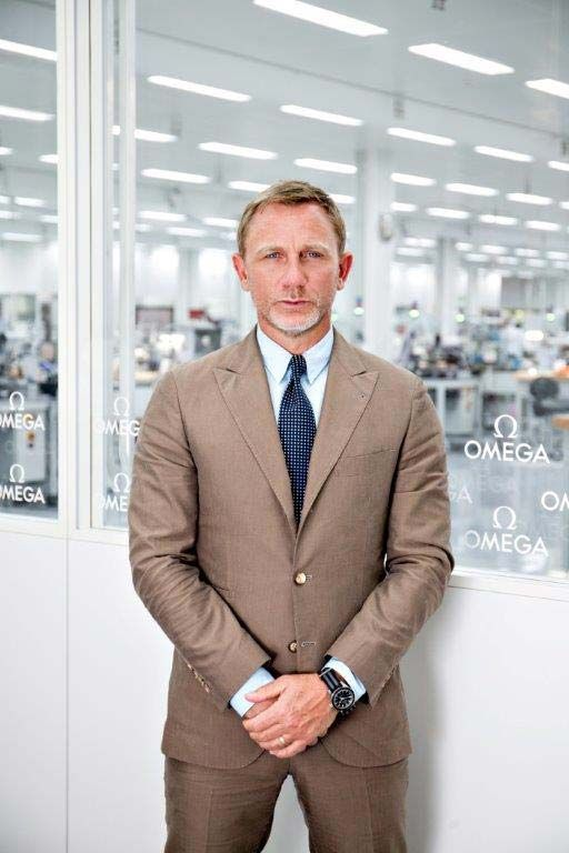 """Daniel Craig at the OMEGA Factory wearing the @omegawatches Seamaster 300 """"Spectre."""" Read more at: http://www.watchtime.com/wristwatch-industry-news/watches/james-bonds-new-watch-the-omega-seamaster-300-spectre-limited-edition/ #omega #watchtime #watchgeek"""