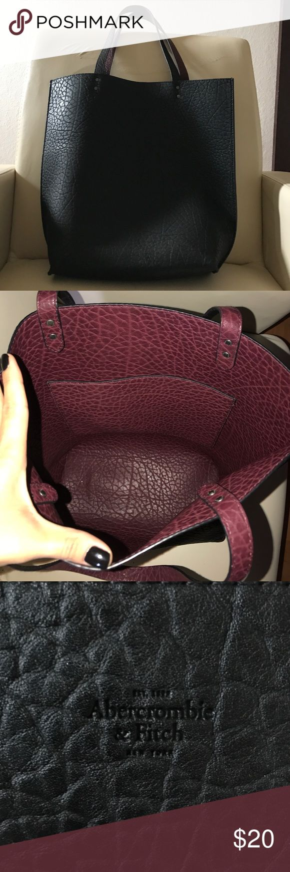 Abercrombie & Fitch handbag Abercrombie & Fitch handbag. Reversible. Black and Burgundy. Shoulder handbag. Very spacious. Comfortable and calls a lot of attention. Perfect for any occasion. Work, beach, daily handbag. Abercrombie & Fitch Bags Shoulder Bags