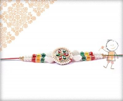 Fancy  #Rakhi Collection 2015 – Send  #Rakhi to #USA #UK #Canada #India #Australia  #Dubai  #NZ #Singapore.  Colorful Traditional Pearl Rakhi, surprise your loved ones with roli chawal, chocolates and a greeting card as it is also a part of our package and that too without any extra charges. http://www.bablarakhi.com/send-fancy-rakhi-online/1139-send-colorful-traditional-pearl-rakhi-online.html