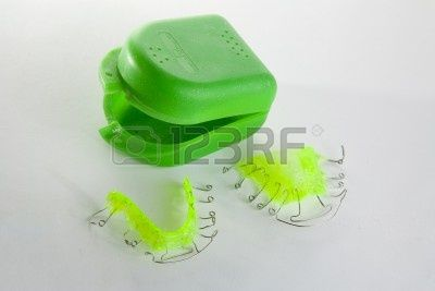 Acrylic dental retainer on white with box