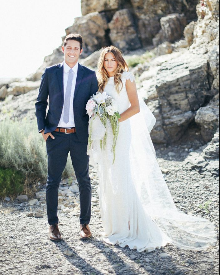 modest wedding dress with unique sleeves and a close to the body fit from alta moda
