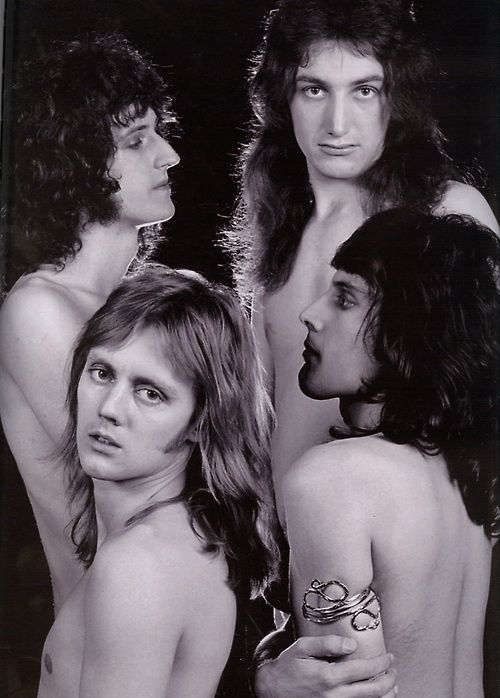 Queen, 1977 by Mick Rock. ° I can just imagine Freddie trying to persuade the rest of the band to do this topless shoot.