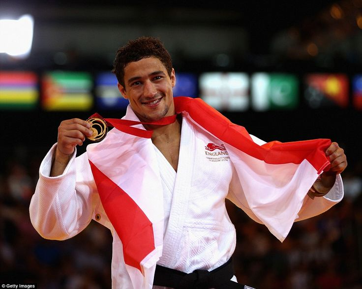 Gold medalist Ashley McKenzie of England poses during the medal ceremony for the Mens -60kg Gold medal contest at theSECC Precinct