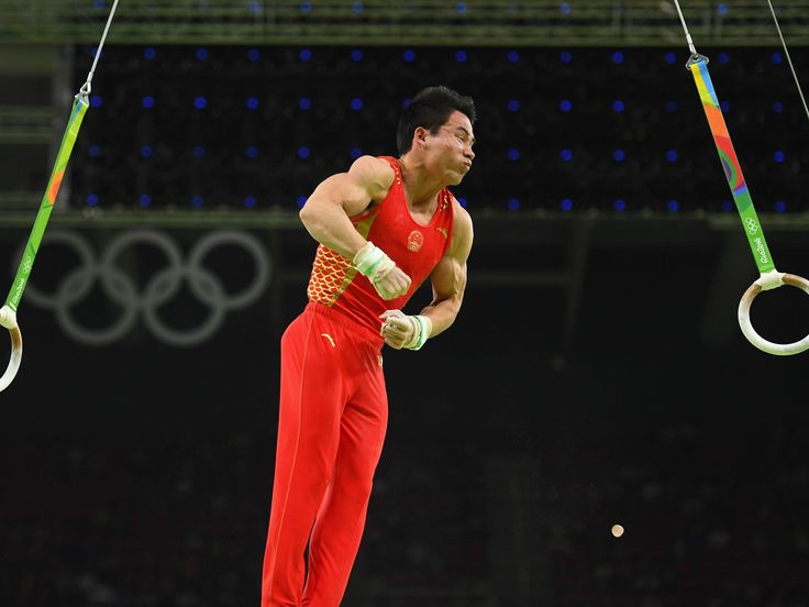 Shudi Deng (CHN) competes on the rings in the men's qualification during the Rio 2016 Summer Olympic Games at Rio Olympic Arena.  Robert Deutsch-USA TODAY Sports