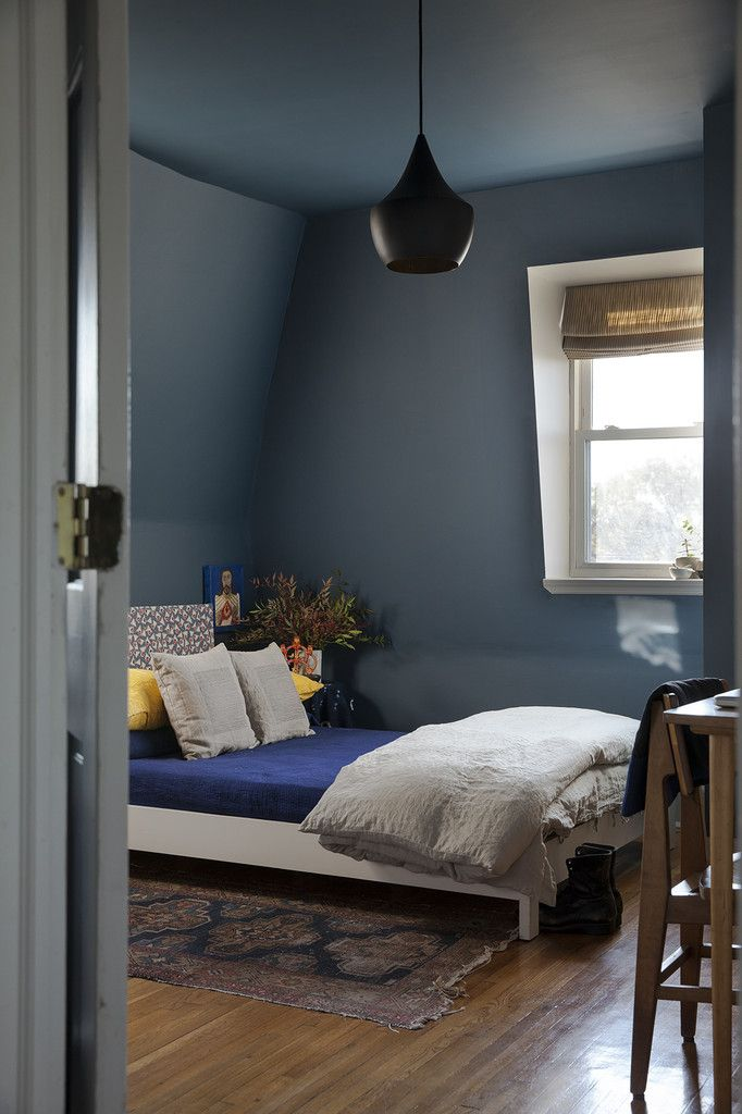 Farrow and Ball Stiffkey Blue unified color helps the odd shaped room and love the pendant, tho $500+ is ridiculous!