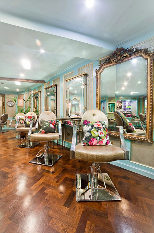 Beautiful gold mirrors with turquoise wall color. The wood floors are gorgeous too. Great blow dry bar inspiration.