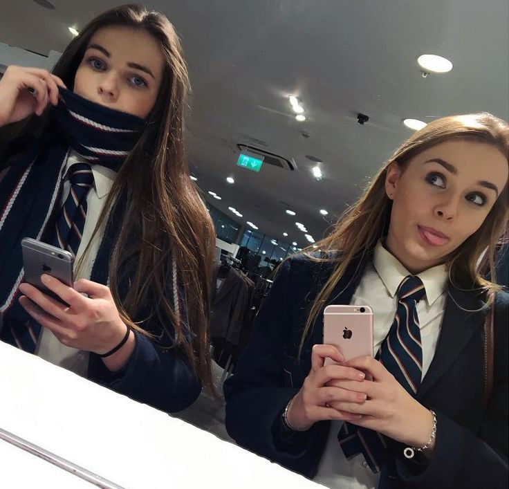 Two Girls Dressed In School Uniforms