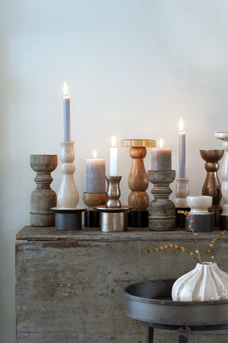 different shapes and materials of candleholders