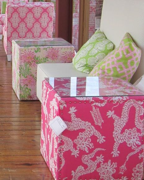 Use basic fabric to cover basic wooden boxes and top with glass to create your own custom tables. (These are in the Lilly store.)