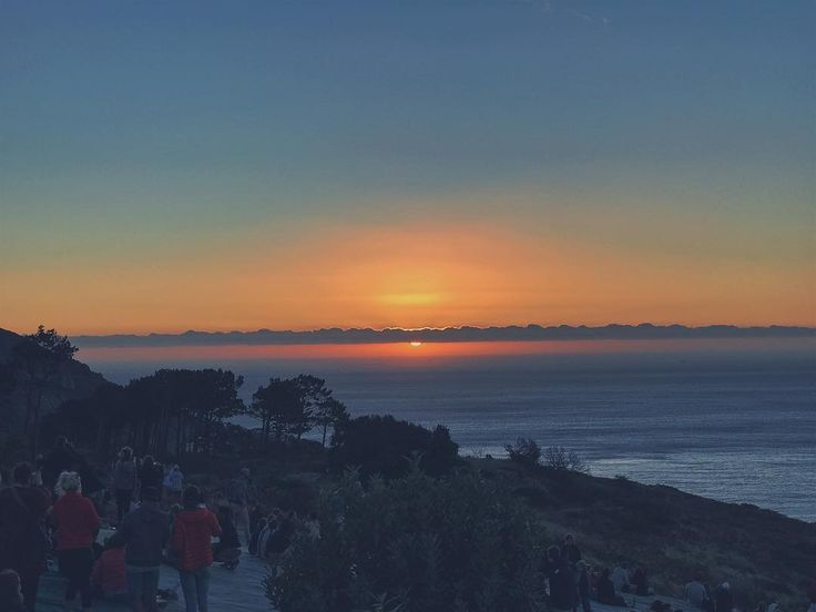 The sunset audience. Simply beautiful. . . . . . . . . . . . . . . . #sunset #people #skyporn #sun #sunsets_captures #signalhill #capetown #tourist #holiday #photooftheday #photo #moodygrams #instaphoto #igphoto #beauty #colours #clouds #photographer #shotoniphone #views #mycity #life #touristinmycity #touristing #colourful #love #happiness