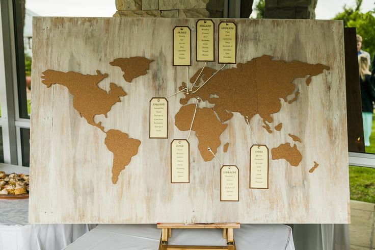 A travel themed seating arrangement board