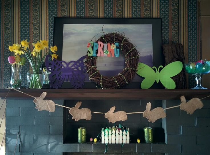 Fun Spring Mantel with bunny banner,  a bowl of pretty eggs and little peeps is so cheerful