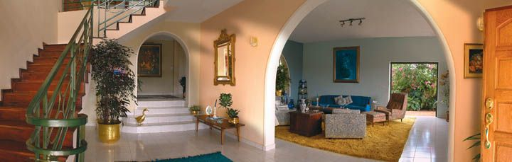 spanish colonial influence on Haitian interior design. with mediterranean arches.