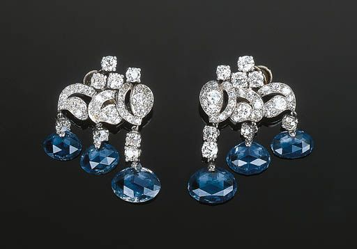 An Attractive Pair of Sapphire and Diamond Ear clips by Cartier   Of old-cut diamond scrolled openwork design, each set with three briolette-cut sapphires suspended from a graduated diamond line, circa 1935, with French assay and maker's marks  Signed Cartier, Paris, No. 01012