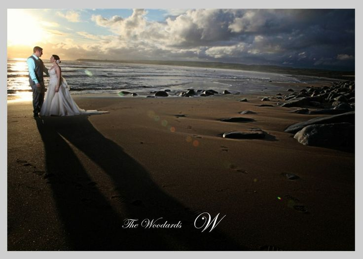 Wedding couple sunset on Co Clare Beach Ireland